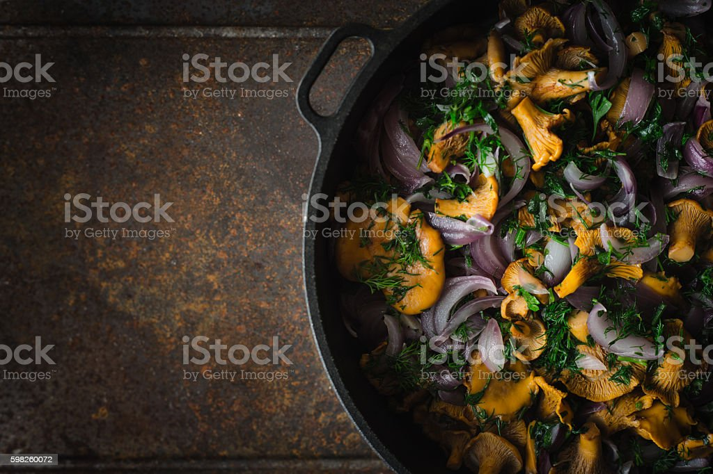 Fried chanterelles in the pan on  metal background top view stock photo