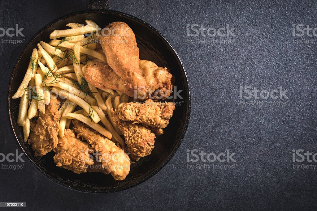 Fried chicken and French fries stock photo