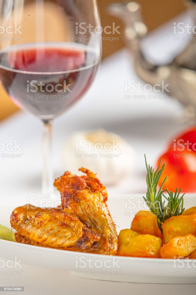 fried chicken and potatoes moroccan style and red wine - Moroccan food menu stock photo