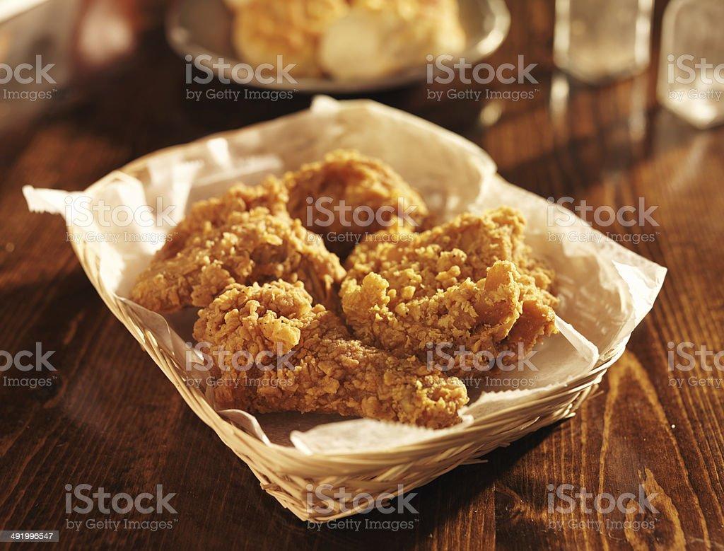 fried chicken basket in golden light stock photo