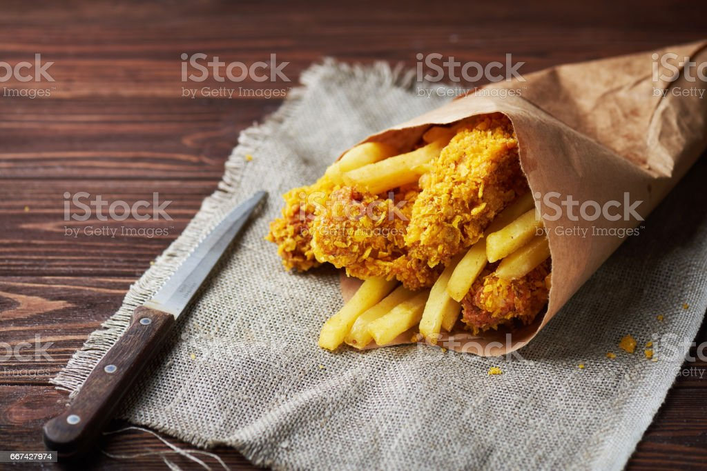Fried Chicken breast on an old rustic wooden background stock photo