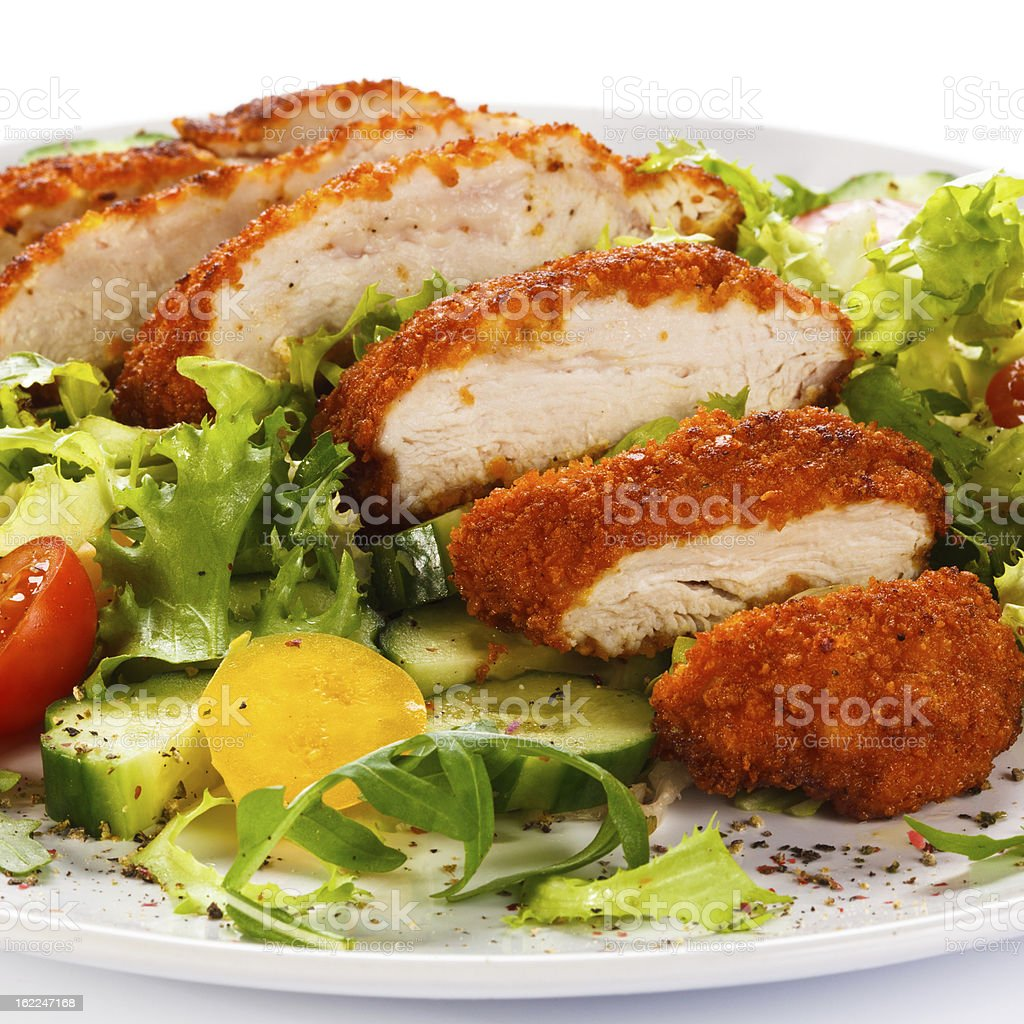 Fried chicken breasts and vegetables royalty-free stock photo