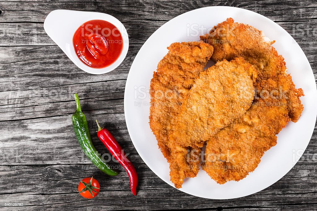 Fried chicken chops on a white dish, top view stock photo