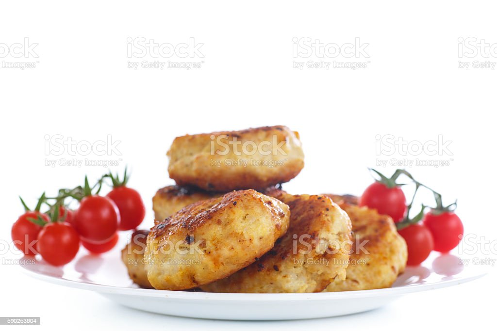 fried chicken cutlet with cherry tomatoes stock photo