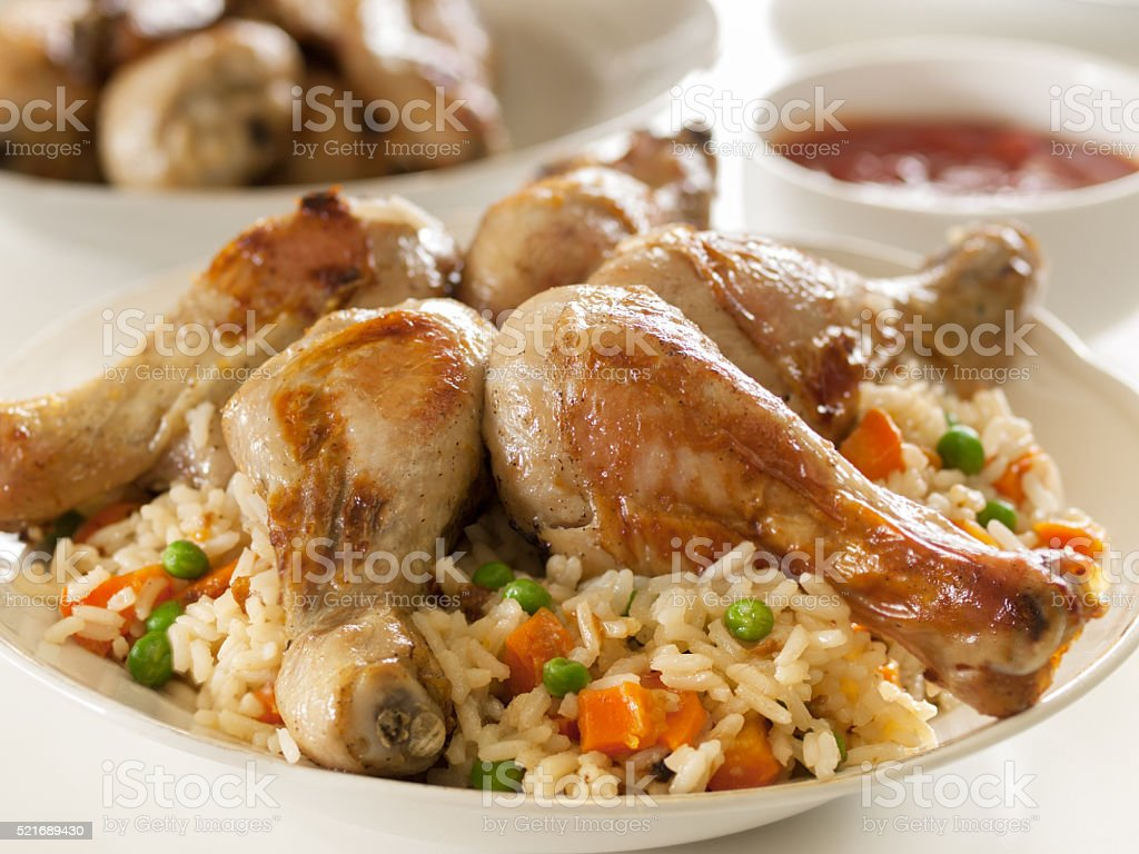 Fried chicken drumsticks or legs with rice and vegetables royalty-free stock photo