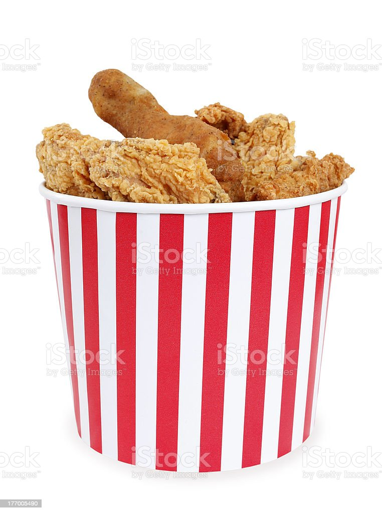 Fried chicken in big red white stripes bucket box stock photo