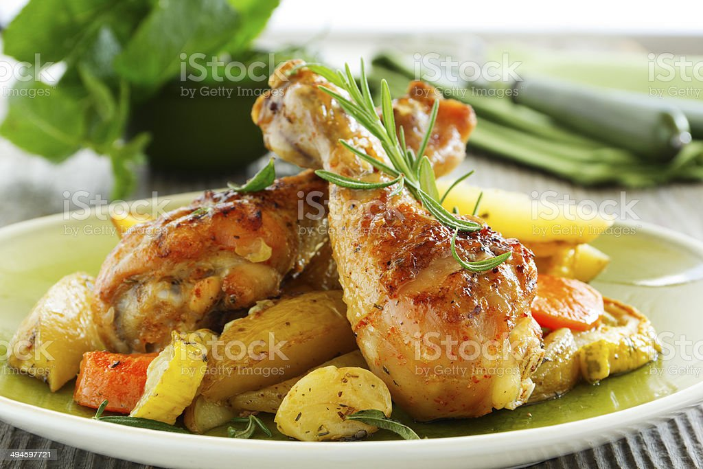 Fried chicken legs with vegetables. stock photo