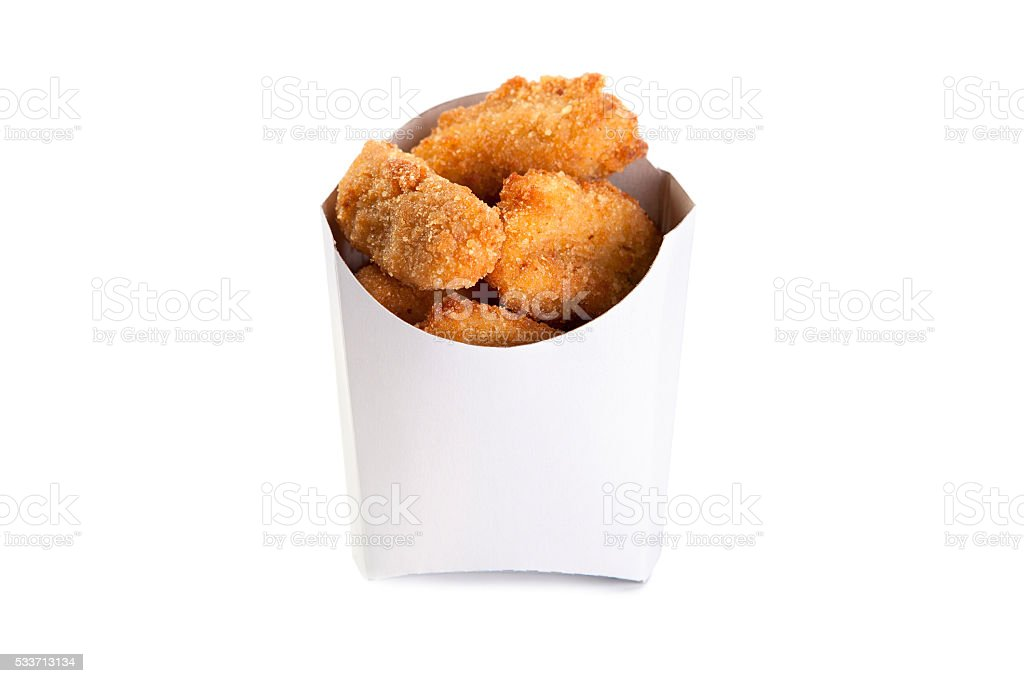 Fried chicken nuggets in a white box isolated stock photo