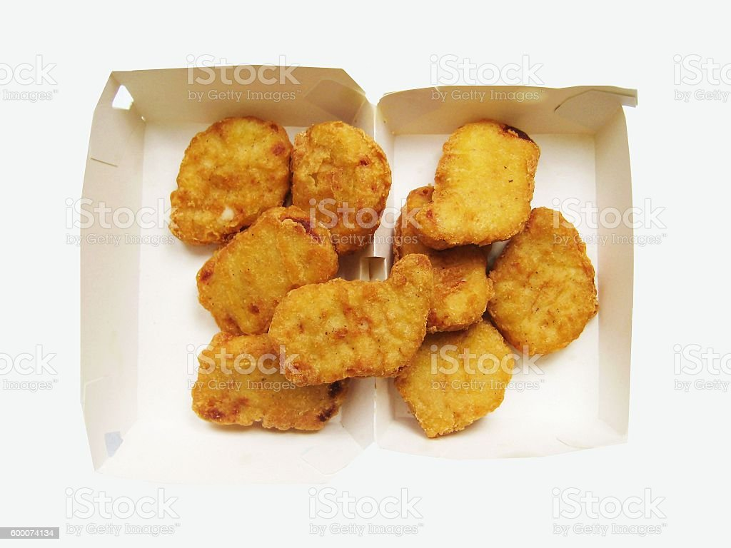 Fried chicken nuggets in box stock photo