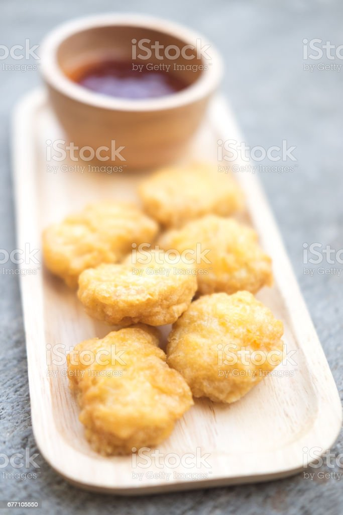 fried chicken nuggets with sauce. Selective focus stock photo