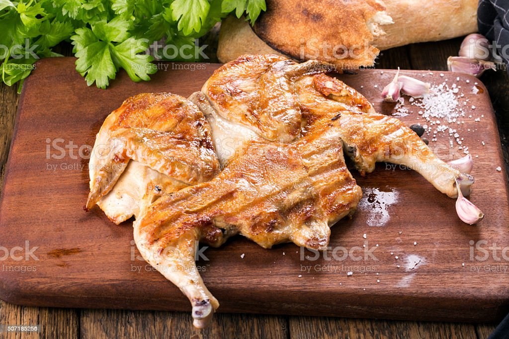 Fried chicken on chopped board. stock photo