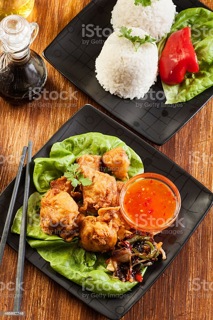 Fried chicken pieces in batter stock photo