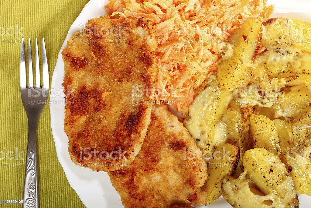 Fried chicken roasted potatos and carrot salad royalty-free stock photo