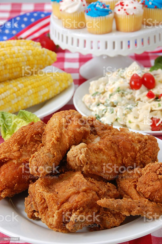 Fried chicken, salad, corn and cupcakes for Fourth of July stock photo