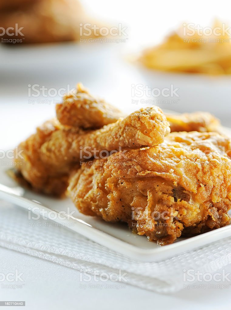 Fried chicken served on white plate stock photo
