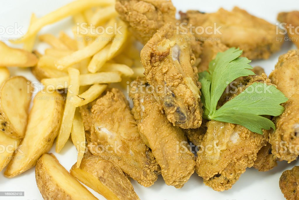 fried chicken wings and potatoes royalty-free stock photo