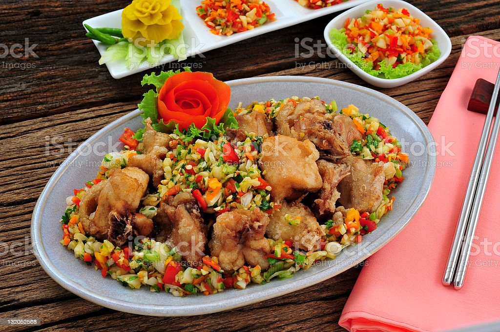 Fried chicken with colorful spice and ingredients in oval plate royalty-free stock photo