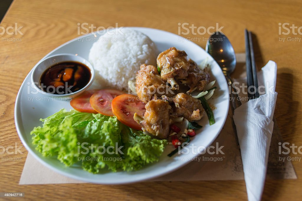 Fried chicken with salad and rice served in Asian restaurant stock photo
