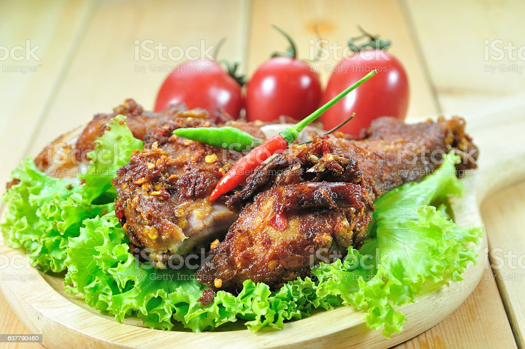 Fried chicken with seasoning set up on table, food stylist stock photo