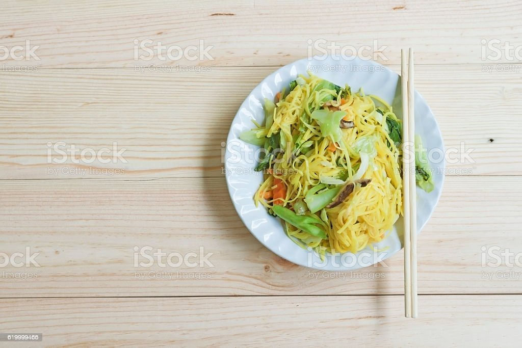 Fried Chinese Yellow Noodle on plate stock photo