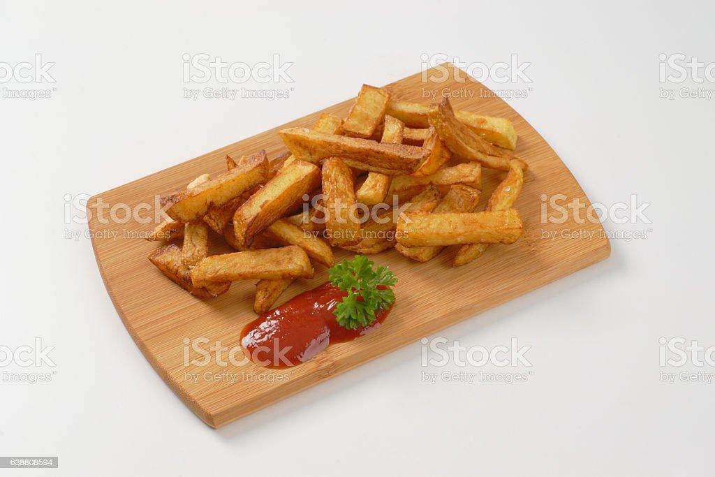 fried chipped potatoes stock photo