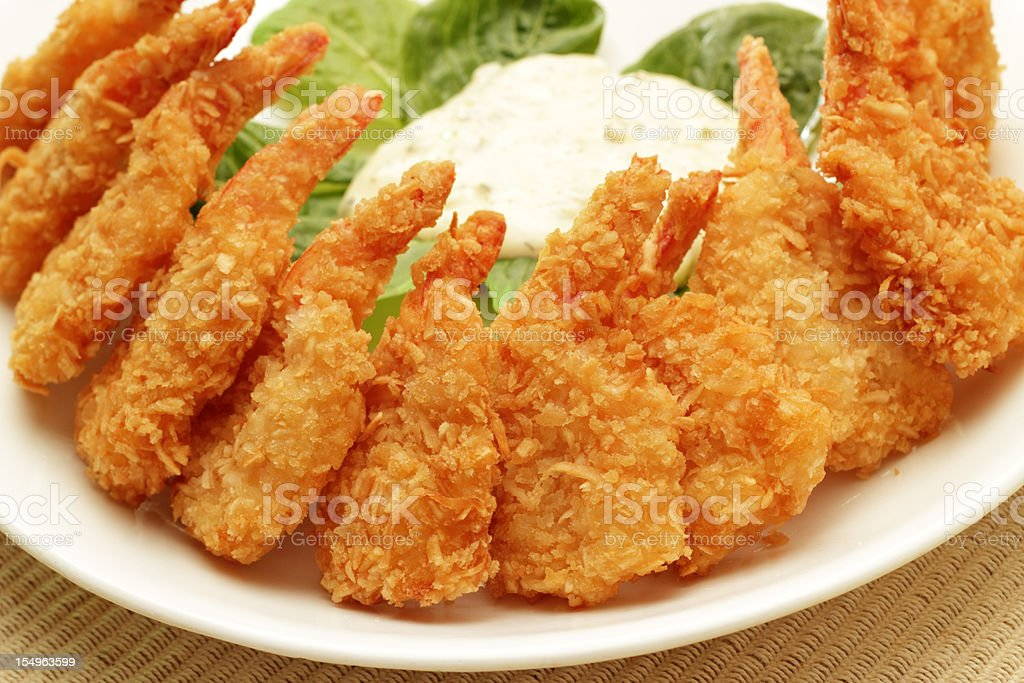 Fried coconut shrimp with dressing royalty-free stock photo