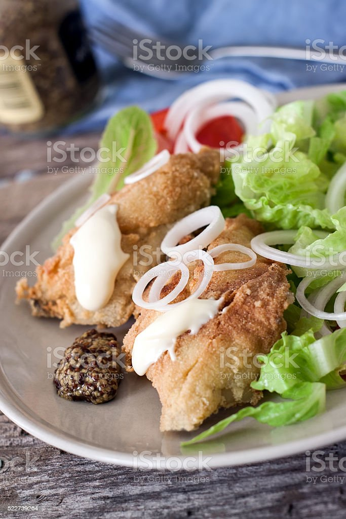 Fried cod and salad stock photo