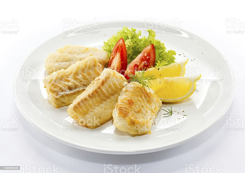 Fried cod fillets and vegetables royalty-free stock photo