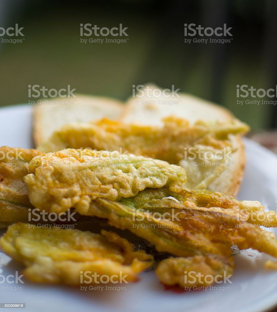 fried courgette flowers stock photo