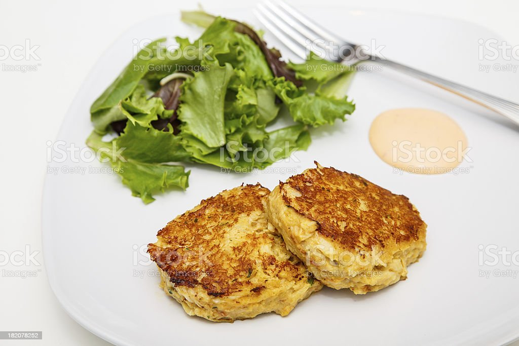 Fried Crab Cakes with Salad and Sauce royalty-free stock photo