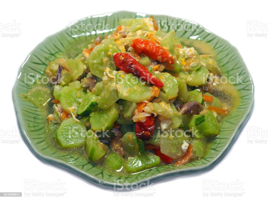 Fried Cucumbers with Egg and garlic and chilli, Thai Food name 'Tang Kwa Pad Khai', Isolated stock photo