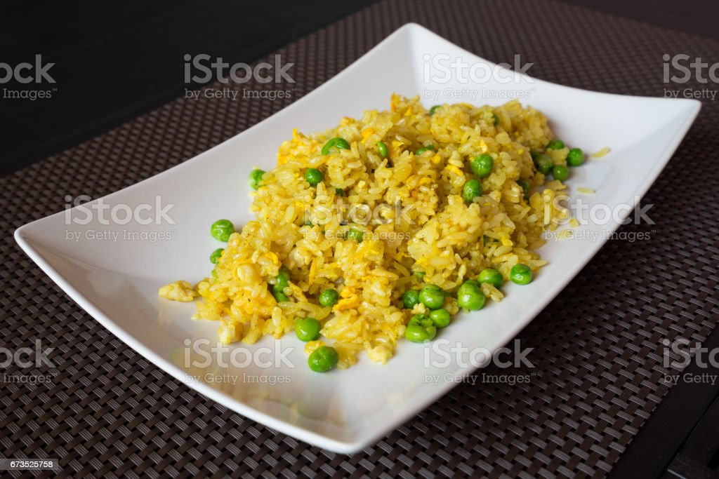 Fried curry rice with peas stock photo