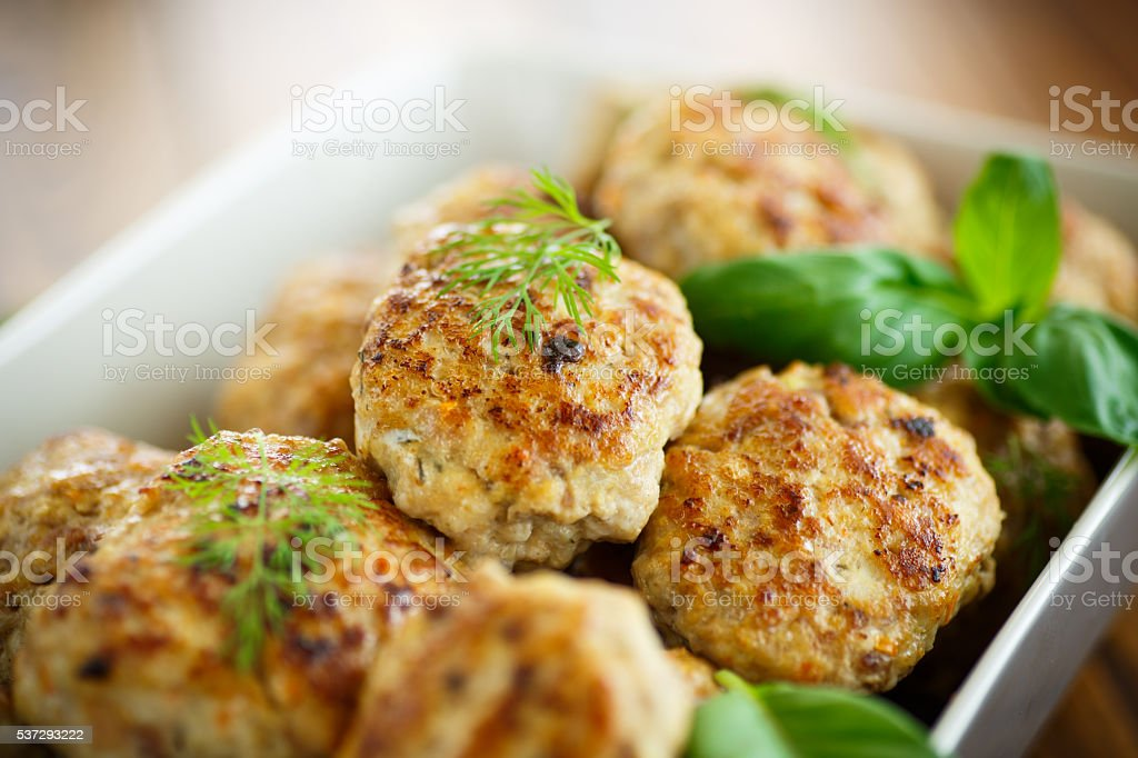 fried cutlet in ceramic form stock photo