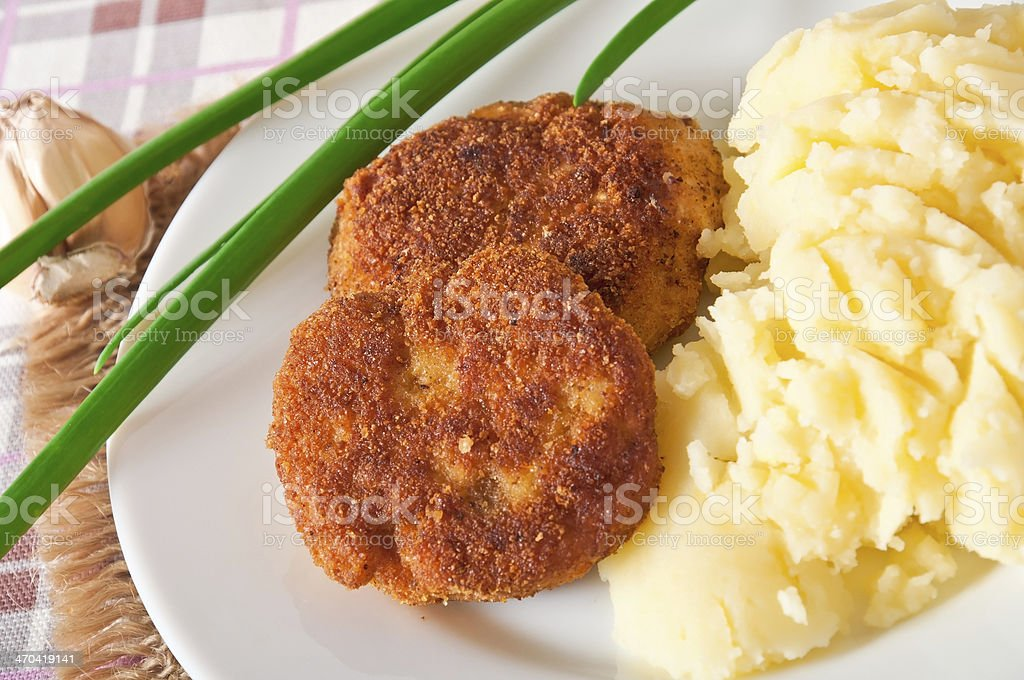 Fried cutlets in breadcrumbs and mashed potatoes royalty-free stock photo