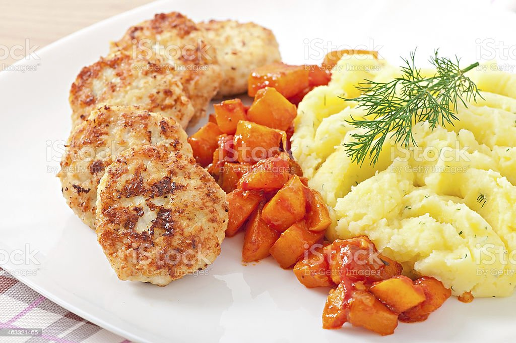 Fried cutlets, stewed pumpkin and mashed potatoes royalty-free stock photo