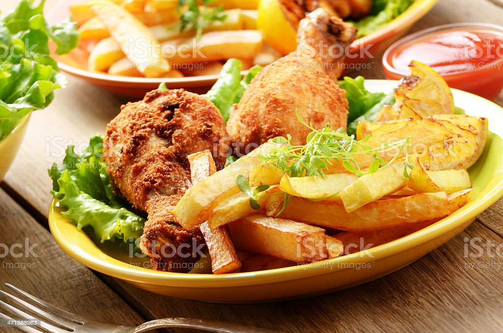 Fried drumsticks with french fries royalty-free stock photo