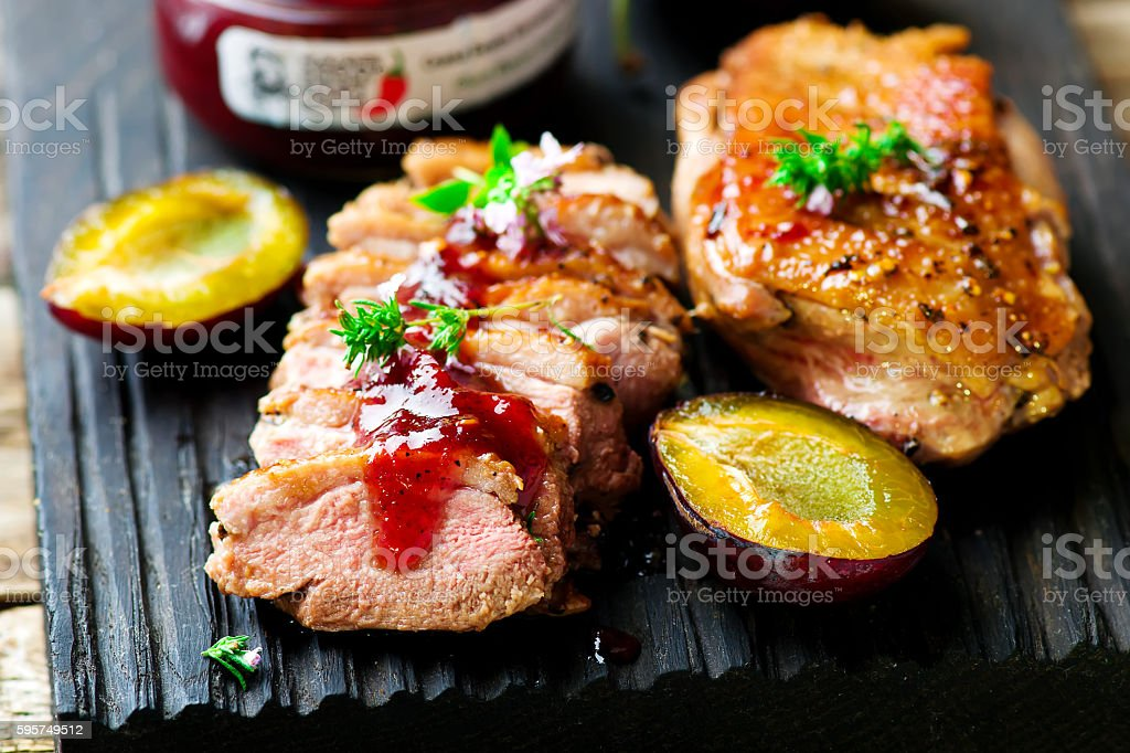 fried duck breast with plum sauce stock photo