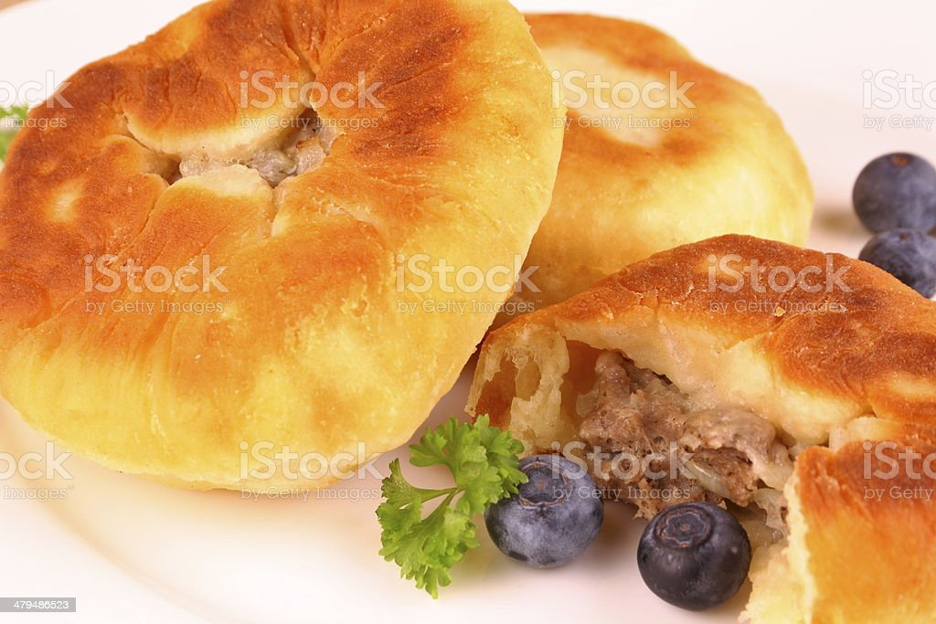 Fried dumplings with meat filling and blueberries stock photo