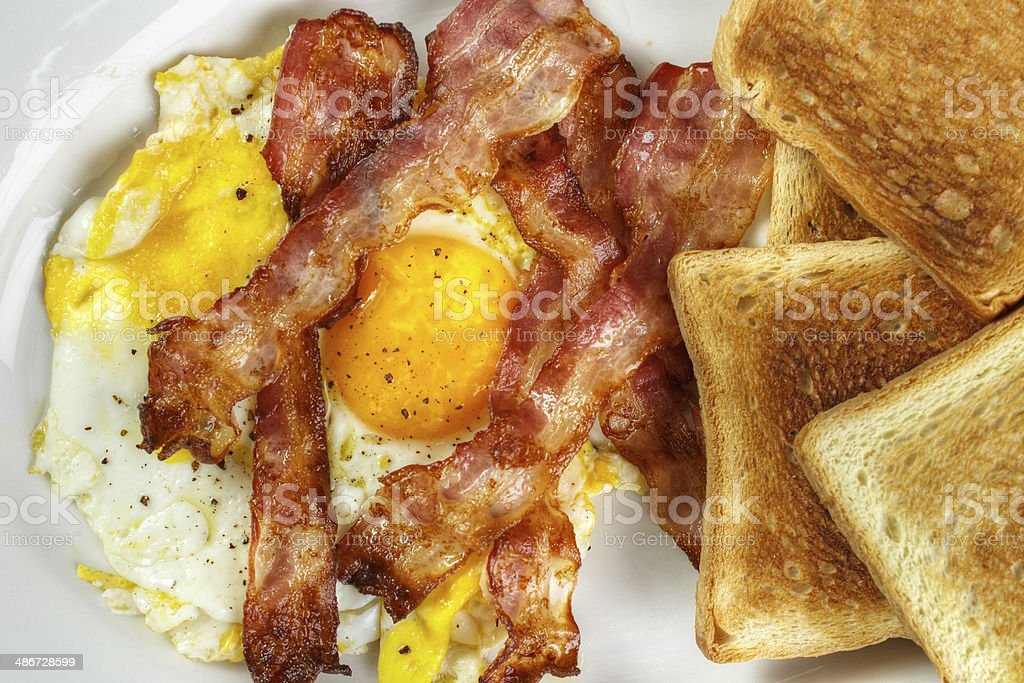 Fried egg and bacon royalty-free stock photo