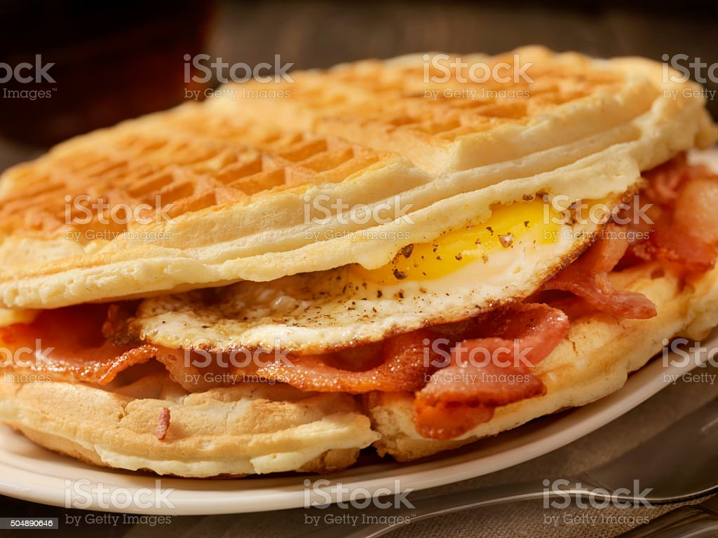 Fried Egg and Bacon Waffle Sandwich stock photo