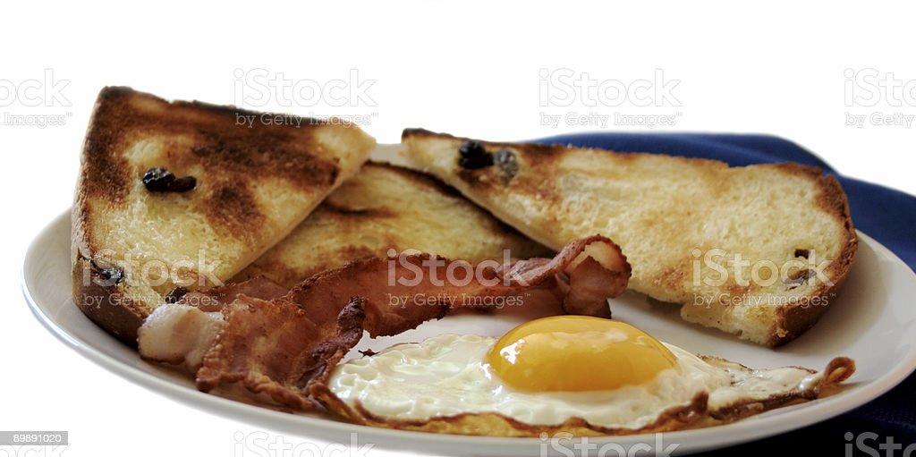 fried egg, bacon and raisin toast royalty-free stock photo