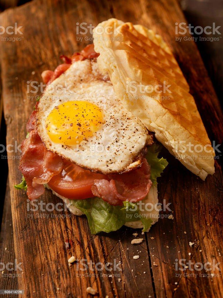 Fried Egg, Bacon, Lettuce and Tomato Waffle Sandwich stock photo