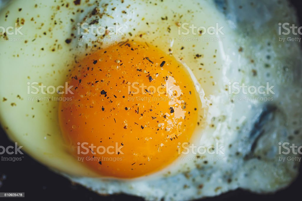 fried egg on the pan stock photo