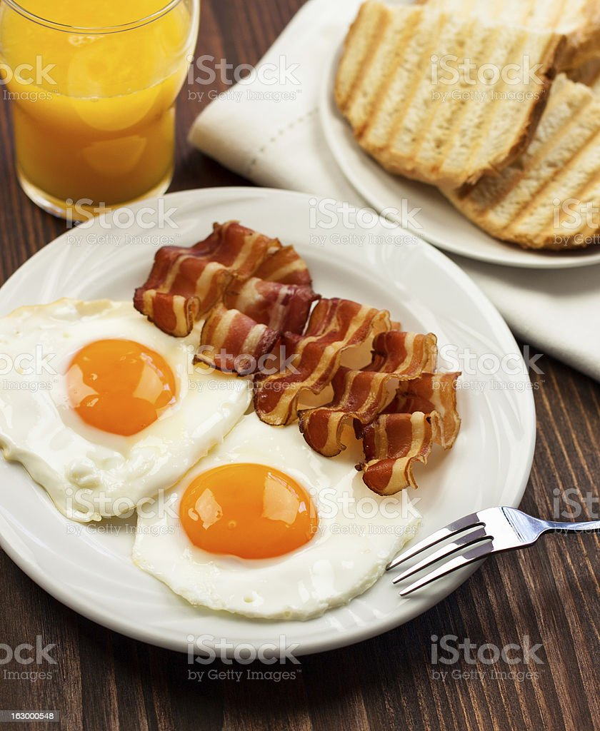 Fried egg with bacon royalty-free stock photo