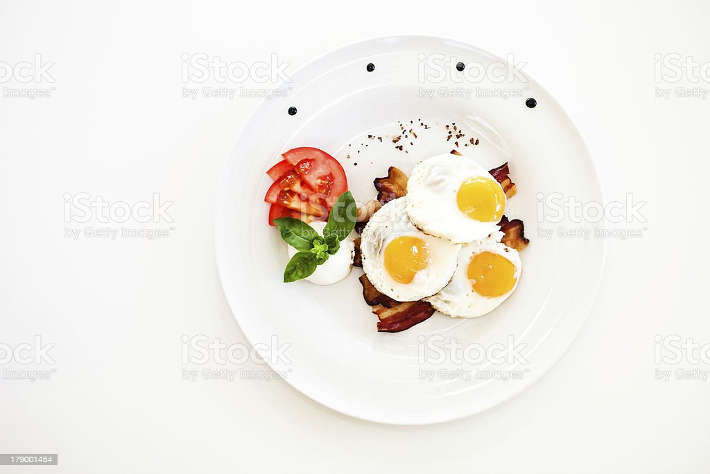Fried eggs and bacon royalty-free stock photo