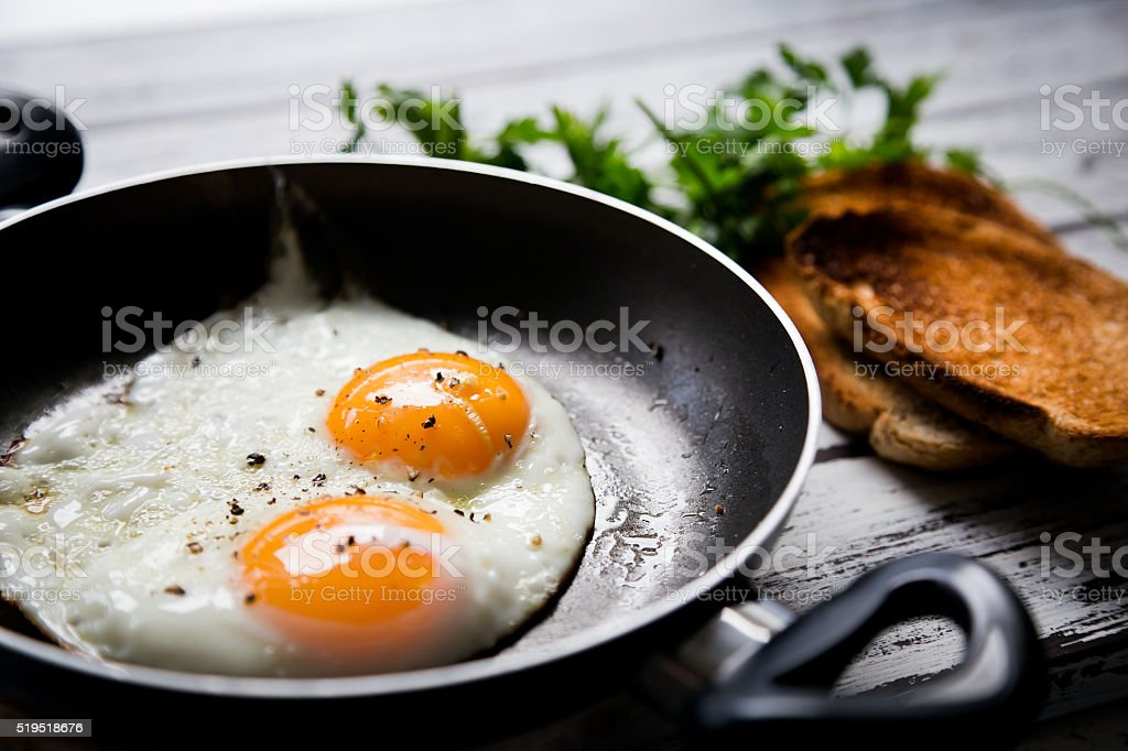 Fried eggs and toasted breads stock photo