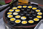 Fried eggs in a pan, thai street food