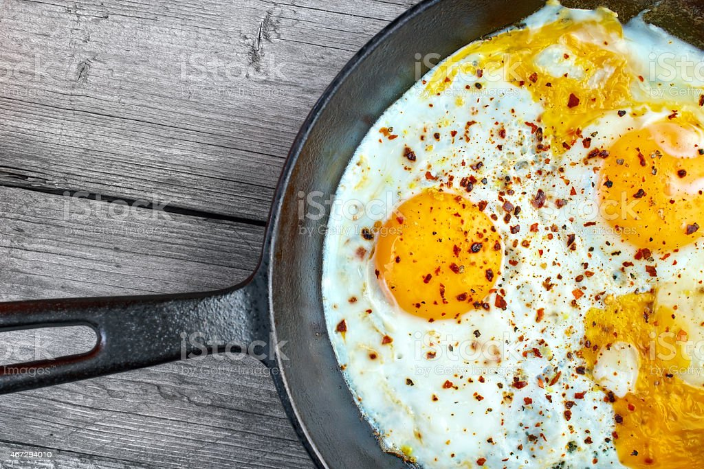 Fried eggs on frying pan closeup royalty-free stock photo