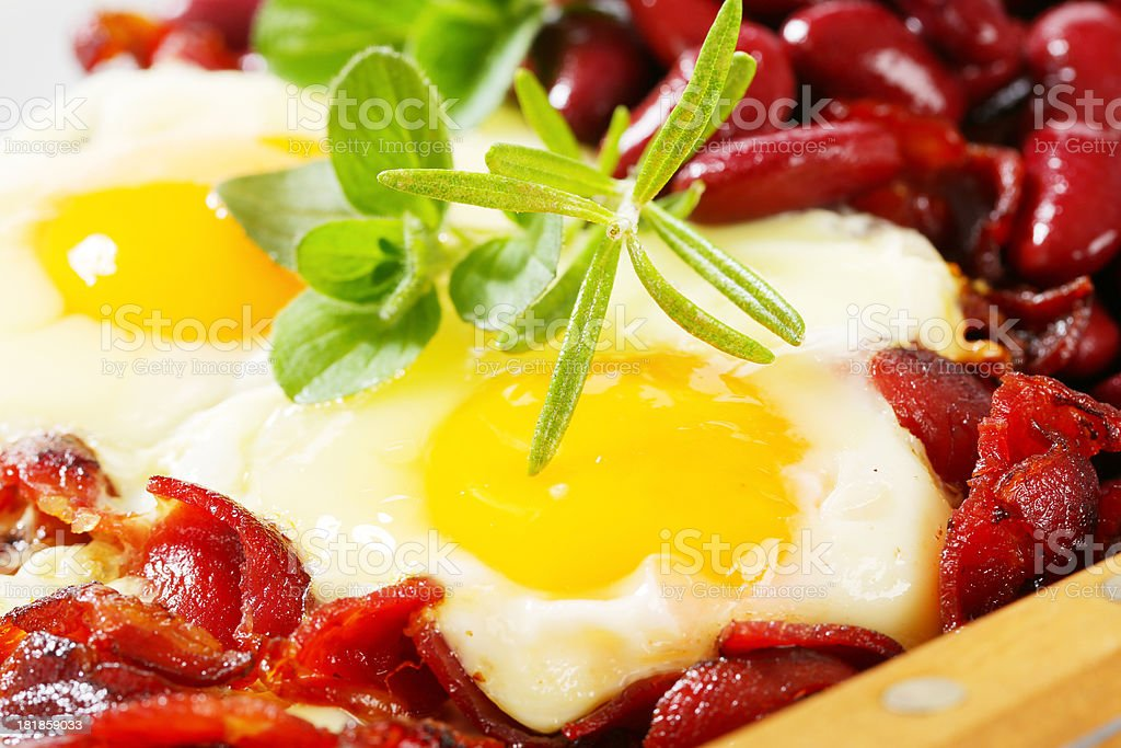 fried eggs with bacon and red beans royalty-free stock photo