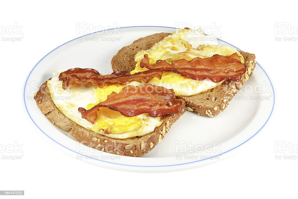Fried eggs with bacon. stock photo